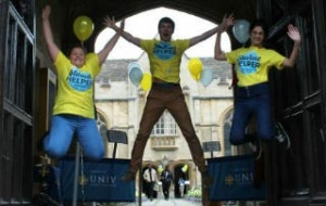 Student Outreach helpers welcoming visitors to University College Oxford