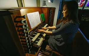 Organ Scholar playing the organ in Univ's Chapel