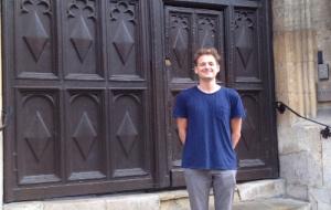 Ethan in front of Univ's door