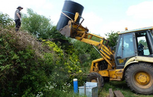 water tank being lifted by tractor