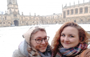 Hannah Armstrong in front of snowy Christ Church with friend