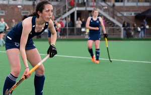Grace Annetts playing hockey