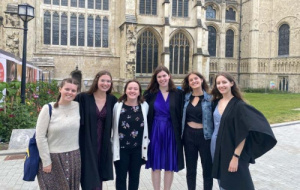 Members of the choir outside the cathedral in the sun