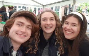 Alexander Walker with friends in a Univ marquee at a casual event