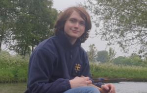 Alexander Walker wearing a Univ fleece while sitting on a punt
