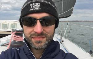 Martin Galpin wearing sunglasses and hat while sailing